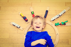 Child playing with trains indoor Stock Photo