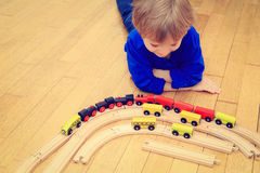 Child playing with trains indoor Royalty Free Stock Images