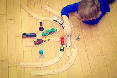 Child playing with trains indoor Royalty Free Stock Photo