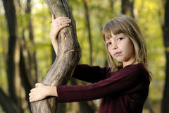child playing with tree Royalty Free Stock Image