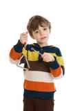 Child playing triangle Stock Image