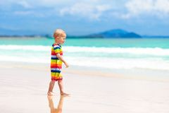 Kids play on tropical beach. Sand and water toy. Royalty Free Stock Photo