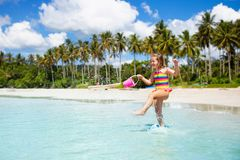 Kids play on tropical beach. Sand and water toy royalty free stock image