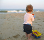 Child Playing with truck at the beach. Child Playing with toy Truck at the beach on the sand Royalty Free Stock Photo