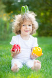 Child playing with vegetables Stock Photo