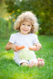 Child playing with vegetables Stock Photography
