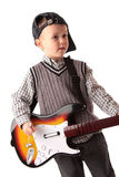 Child playing video game. Young child playing whammy bar on video game guitar like he is in a rock band Royalty Free Stock Photography