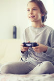 Child playing video game Royalty Free Stock Images