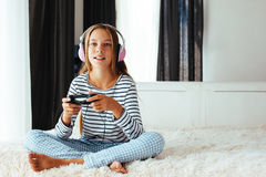 Child playing video game Royalty Free Stock Photo