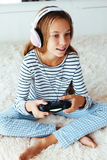 Child playing video game Stock Photo