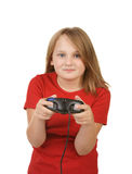 Child playing video games,. Young girl playing video games on white Stock Image