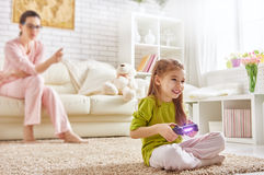 Child playing video games Stock Images