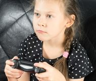 Child playing video games. And holds joystick or controller Royalty Free Stock Photography