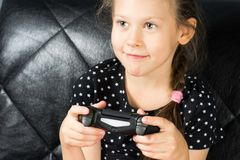 Child playing video games. And holds joystick or controller Stock Photography