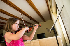 Child playing violin Royalty Free Stock Image