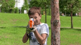 The child is playing in the war. Game on green grass. Summer vacation. stock footage
