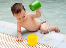 Child playing with water Stock Image
