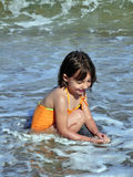Child Playing in Water Stock Photo
