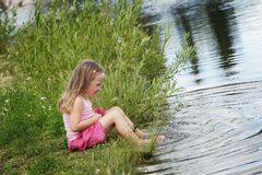 Child Playing By The Water Royalty Free Stock Image