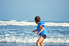 Child playing with water Stock Photography
