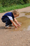 Child playing with water Stock Photos