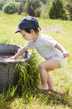 Child playing with water Royalty Free Stock Photography