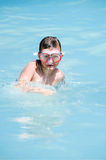 Child playing in water Stock Images