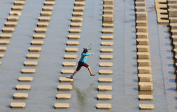 A child playing water in the  Dam water Colo Nguter Sukoharjo Ce Stock Images