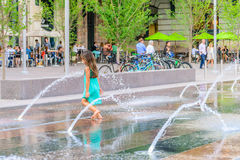 Child playing in a water feature in front of Union Station in Denver Colorado Royalty Free Stock Photo