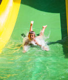 Child playing on water slide Stock Photography