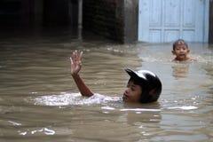 Child playing water stock photo