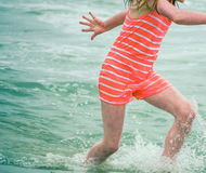 Child Playing In The Waves Royalty Free Stock Photography