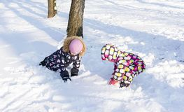 Child playing on winter snowy day. On the nature. Child playing on a swing in winter.  On the nature Royalty Free Stock Image