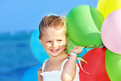 Child Playing With Balloons . Royalty Free Stock Image
