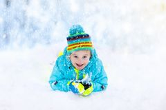 Free Child Playing With Snow In Winter. Kids Outdoors. Royalty Free Stock Photos - 101314188