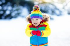 Free Child Playing With Snow In Winter. Kids Outdoors. Royalty Free Stock Photos - 102720288