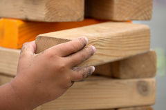 Child playing with the wood game Royalty Free Stock Photo