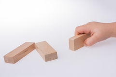 child playing with wooden building blocks Royalty Free Stock Photo
