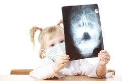 Child playing with X-ray photograph Stock Photography