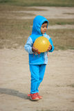 Child is playing with a yellow ball. Child is playing in the field Royalty Free Stock Photo
