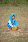 Child is playing with a yellow ball. Child is playing in the field Stock Photos