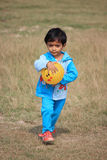 Child is playing with a yellow ball. Child is playing in the field Royalty Free Stock Photos