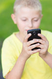 Child playing on your smartphone Royalty Free Stock Photo