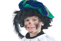 Child playing Zwarte Piet or Black Pete. Young child playing Zwarte Piet (Black Pete), this is a Dutch tradition when Sinterklaas is celebrated in december Stock Photo