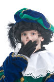 Child playing Zwarte Piet or Black Pete. Young child playing Zwarte Piet (Black Pete), this is a Dutch tradition when Sinterklaas is celebrated in december Royalty Free Stock Image