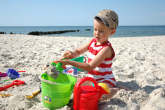 Child playint with toys on the beach Stock Photo