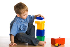 Child Plays About Cubes Stock Photography