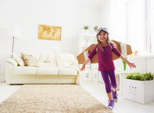 Child plays in an astronaut costume Royalty Free Stock Photos