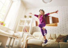 Child plays in an astronaut costume Stock Photography