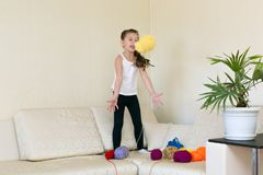 The child plays with the balls of spools of thread royalty free stock photography